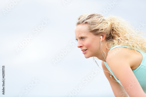 Runner woman resting after running workout