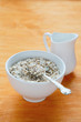 flakes in a bowl and jug with milk