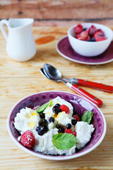 fresh cheese with berries in a bowl