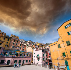 Cloudy sky over Cinque Terre buildings, Italy