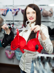 Girl choosing underwear at clothing store