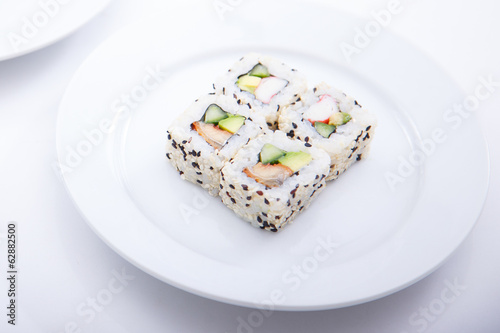 A round plate with four same sushi pieces