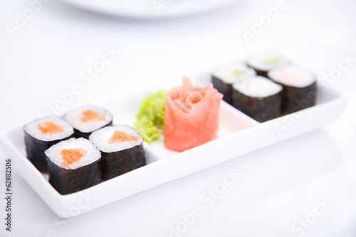 Eight sushi with salmon and different ingredients