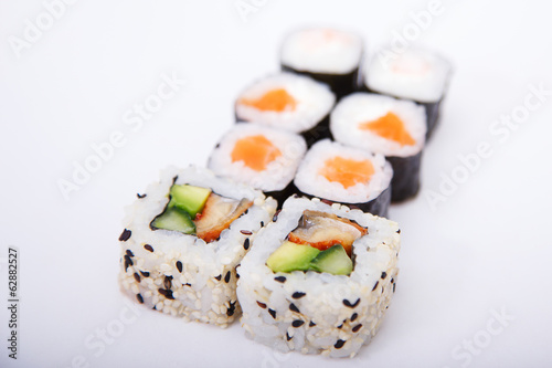 Some different sushi on a white surface