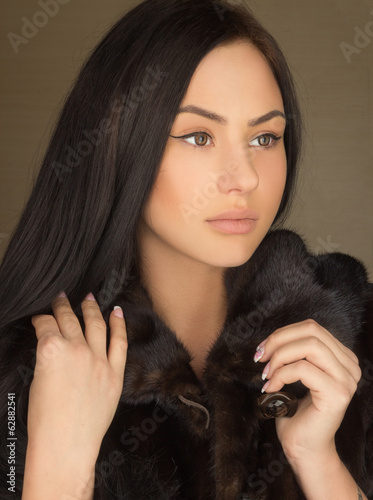 beautiful sexy girl in a fur coat