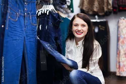 Smiling Woman choosing jeans