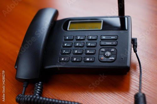 A business phone with a cord