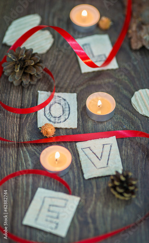 Love letters, candles and a red string