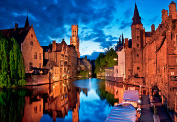 Historic medieval buildings along a canal in Bruges, Belgium