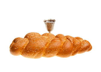 Challah and Silver Kiddush cup for Jewish Sabbath