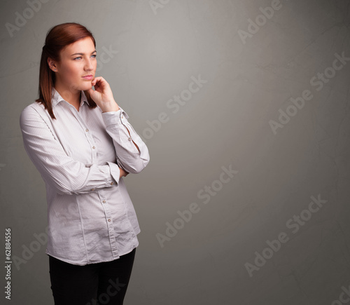 Beautiful woman thinking with empty copy space