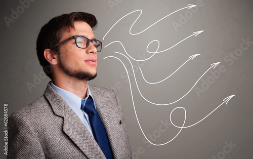 Attractive man looking at multiple curly arrows