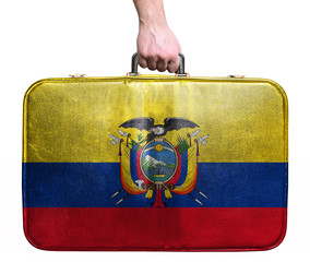 Tourist hand holding vintage leather travel bag with flag of Ecu