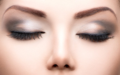 Beauty eyes makeup closeup. Long eyelashes, perfect skin