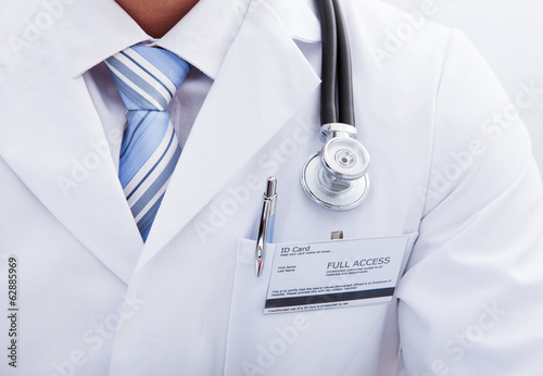 Pocket on a lab coat with a doctors ID tag and pen