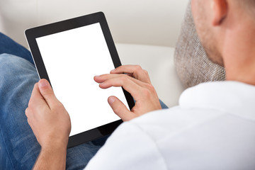 Man using his fingers to navigate on a tablet-pc