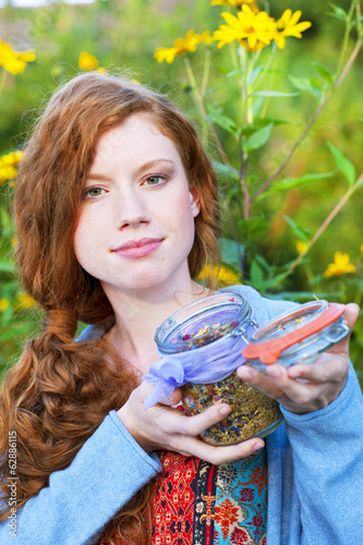 Red haired woman with dried herbs