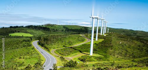 Row of wind turbines in a wind farm