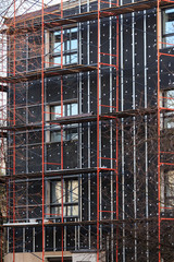 exterior insulation of building facade under construction