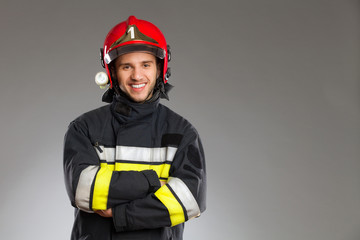 Fireman posing wth arms crossed.