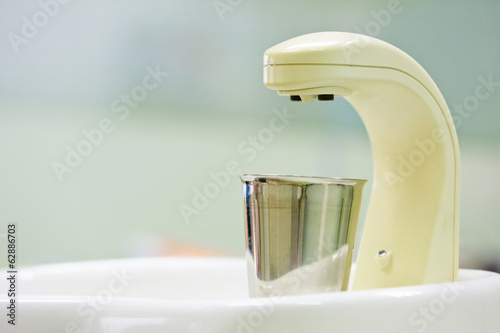 Sink at a dental unit in dental office,faucet. and spittoon