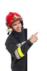 Fireman pointing at the banner