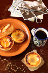 Portuguese Custard Tarts with a cup of coffee