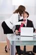 Sensuous Secretary Seducing Businessman At Desk
