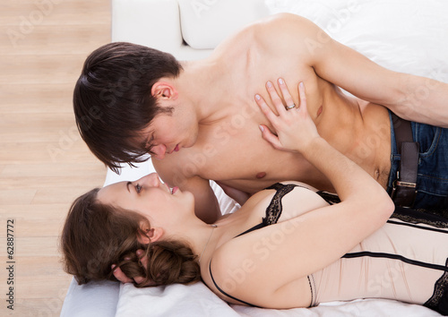 Lusty Couple Looking At Each Other In Bed