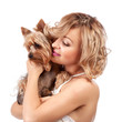 Cute young woman cuddling her dog