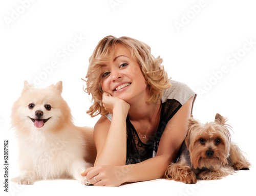 Cute young woman cuddling her dogs