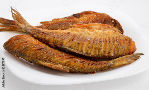 Fried river fish with the cutting back.
