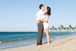 Affectionate Couple Kissing At Beach