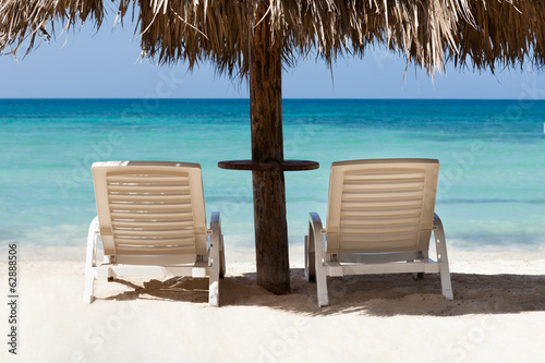 Lounge Chairs Under Sunshade At Beach