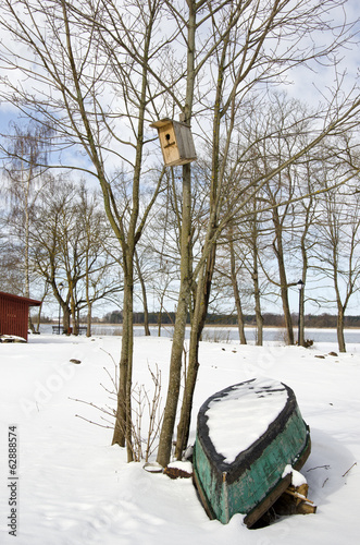 winter end boat and nesting-box on tree