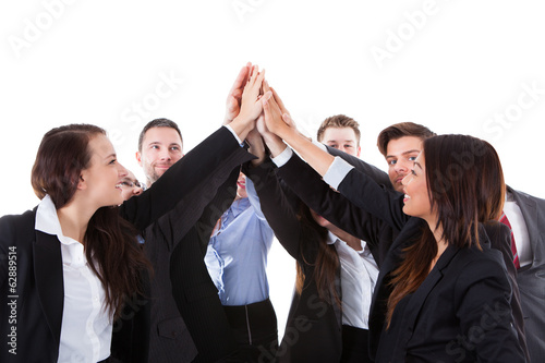 Businesspeople making high five gesture