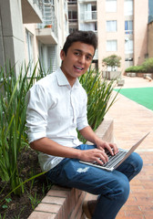Brazilian student with notebook on a campus