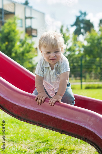 Baby boy on a slide