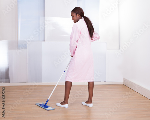 Housekeeper Mopping Floor In Hotel