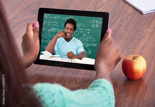 Teacher Assisting Student Through Video Conferencing