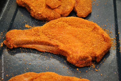 Raw Breaded Pork Chops in a Pan