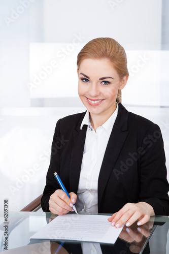 Businesswoman Signing Document