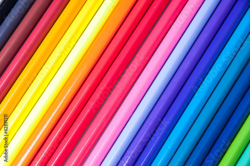 Multicolored pencils laid out by colors