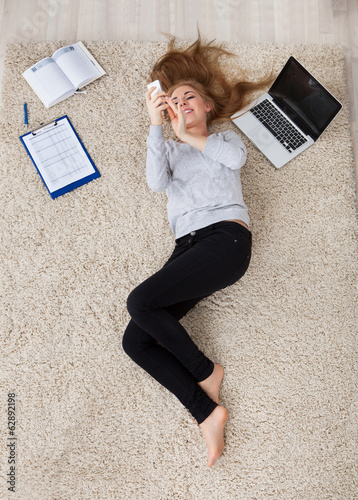 Young Woman Lying On Carpet