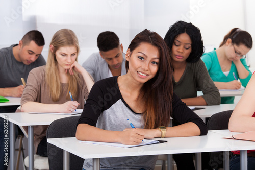 Female college student sitting at desk