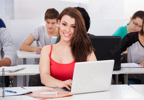 Beautiful University Student With Laptop At Desk