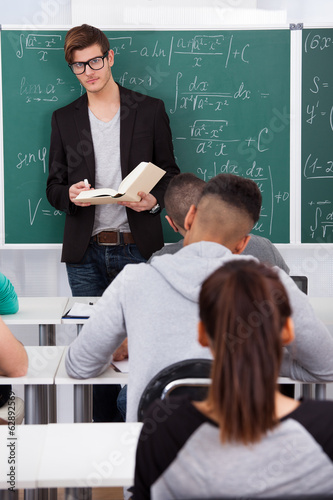 Teacher Teaching Mathematics To Students