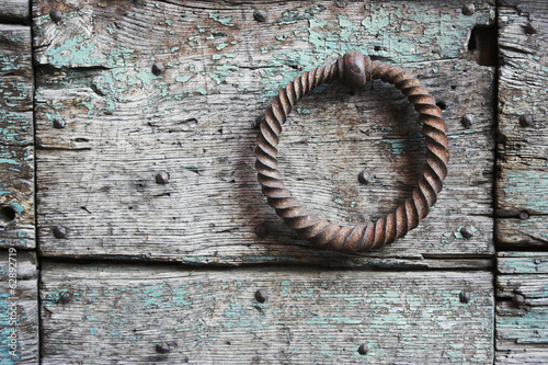 Old knocker on a wooden door