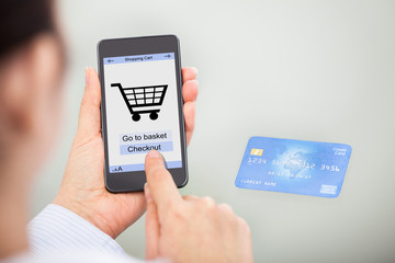 Businessperson Shopping Online With Mobile Phone And Credit Card