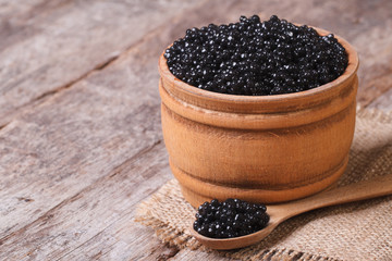 black sturgeon caviar in a wooden a barrel